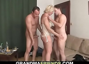 Hot threesome mating with blonde mature woman