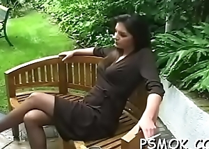 Beauties sharing a cigarette while giving a dishevelled blowjob