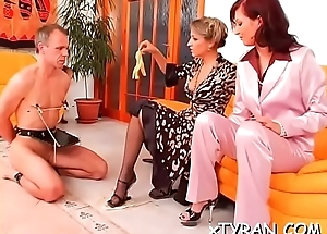 Naughty domme sucks slave'_s hard dick and rides him rough