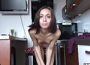 Thin young Susan spread their way legs in the kitchen