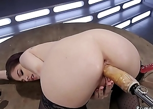 Brunette in stockings fucks monster machine