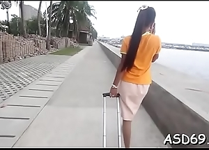 Talented asian beauty sucks a schlong and grinds on it hard