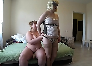 A make obsolete with a strapon fucks a pregnant lesbian, shaking a juicy ass and shaking natural tits with big nipples.