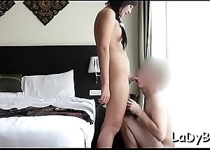 Dispirited looking oriental ladyboy favors her stud with a sexy blow
