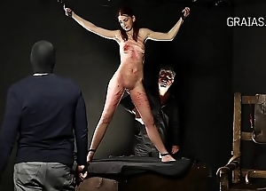 Petite redhead tied to a chair and punished