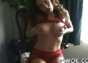 Naked bombshell with wonderful tits enjoys a relaxing smoke session