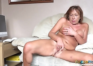 Ancient bitch undresses and fingers her mature twat