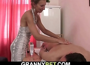 Guy fucks small-titted granny masseuse