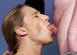 Flirty hottie gets cum shot in excess of her face eating all the juice